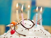 Birthday cake candle stock images