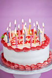 Birthday cake with candles. Birthday cake with lit candles and white icing Royalty Free Stock Image