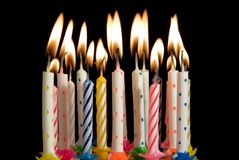 Birthday cake candles. Pretty birthday cake candles flickering Stock Images