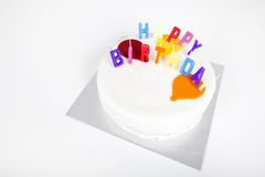Birthday cake with candles against white background Royalty Free Stock Photos
