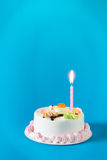 Birthday cake with candles on color background Stock Images