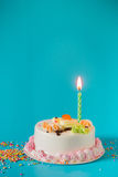 Birthday cake with candles on color background Royalty Free Stock Image