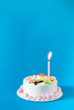 Birthday cake with candles on color background Stock Image