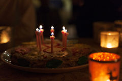 Birthday cake with candles and colorful bokeh Stock Photography