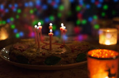 Birthday cake with candles and colorful bokeh Royalty Free Stock Photography