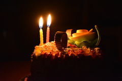 Birthday. Cake and candles glowing in dark is an awesome photo Stock Image