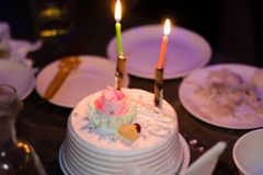 Birthday cake candles. Light up the evening Royalty Free Stock Photography