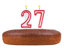 Birthday cake with candles number 27 isolated. On white background Stock Photo