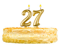 Birthday cake with candles number twenty seven. Isolated on white background Stock Photo