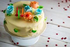 Birthday cake with candles and sugar roses Stock Image