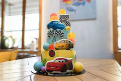 Birthday cake with cars illustration. Cartoon character cake for child party. Thematic event