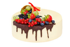 Birthday cake with chocolate and fruits isolated over white, selective focus stock image