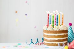 Birthday cake. With colorful candles at a birthday party Stock Photography
