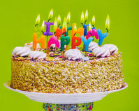 Birthday cake with colorful happy birthday candles Royalty Free Stock Photos