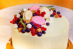 Birthday cake with cream, fresh fruit and berries slide. Stock Photos