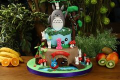 Kids birthday party cake - forest consept. Birthday cake decorated with forest, rabbit, bunny mushroom, home and river stock images