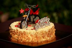 Birthday cake decorated with motorcycle and red stars Royalty Free Stock Photo