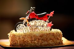 Birthday cake decorated with motorcycle and red stars Royalty Free Stock Image