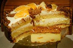 Birthday cake. Decorated with orange fruits Royalty Free Stock Image