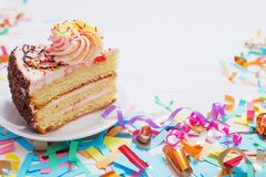Birthday cake and decoration on white wooden background royalty free stock images
