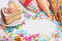 Birthday cake and  decoration on white background royalty free stock photo