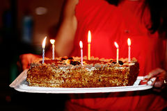 Birthday cake. Delicious birthday cake with candles from Mom stock photography