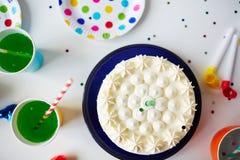 Birthday cake and drinks Stock Photo