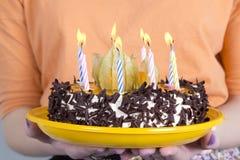 Birthday cake in female hands Stock Image