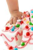 Birthday cake fingers Stock Photo