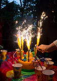 Birthday cake. Fireworks on the birthday cake Royalty Free Stock Photos
