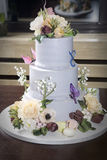 Birthday cake with flower,  butterfly on table Royalty Free Stock Images