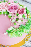 Birthday cake with flowers rose on white background Stock Image