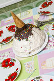 birthday cake in the form of a cone with ice cream on the table Stock Photos