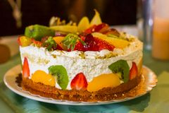 Birthday Cake full of fresh cream and fruit royalty free stock images