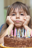 Birthday cake and a girl Royalty Free Stock Image