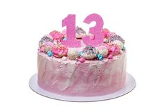 A birthday cake for a girl of thirteen. royalty free stock photos