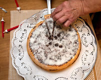 Birthday cake from grandma. Grandma slicing a birthday cake royalty free stock photography