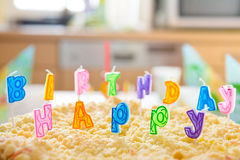 Birthday cake with happy birthday letters Stock Image