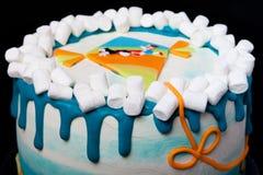 Birthday cake with inscription 'Happy birthday, Juliana' on blue background Royalty Free Stock Photos