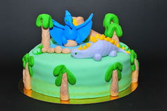 Birthday cake for kids who love dinosaurs. Beautifully crafted dinosaurs theme cake stock images