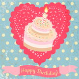 Birthday cake and lace heart on the vintage background. Royalty Free Stock Image