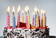 A birthday cake with lighted candles Royalty Free Stock Image