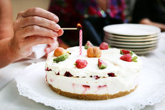 Birthday cake lighting a candle, celebration Royalty Free Stock Photo