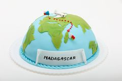 Birthday cake like globe, travel concept. With Madagascar destination Stock Photo