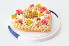 Birthday cake like heart with different candies stock photo