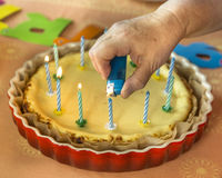 Birthday cake with lots of candles Stock Image