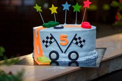Birthday cake with mastic stars and cars figures for boy. 5 years old