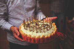 Birthday cake in men's hands Royalty Free Stock Photography