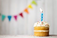 Birthday cake. Mini birthday cake with a single candle Royalty Free Stock Image