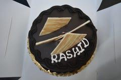 Birthday cake with name Rashid stock photography